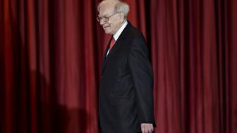 Warren Buffett, chairman and chief executive officer of Berkshire Hathaway Inc., arrives on stage during an event with Hillary Clinton, former Secretary of State and 2016 Democratic presidential candidate, not pictured, at the Sokol Auditorium in Omaha, Nebraska, U.S., on Wednesday, Dec. 16, 2015. Buffet said at the rally that he was supporting Clinton's bid for president because they share a commitment to help the less affluent. Photographer: Daniel Acker/Bloomberg via Getty Images