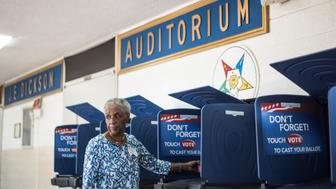COLUMBIA, SC - FEBRUARY 27: Poll worker Mary Ellison prepares a voting machine at the Prince Hall Masonic Lodge during the South Carolina Democratic Presidential Primary February 27, 2016 in Columbia, South Carolina. Voters in 12 states and one U.S. territory will participate in Super Tuesday on March 1. (Photo by Sean Rayford/Getty Images)