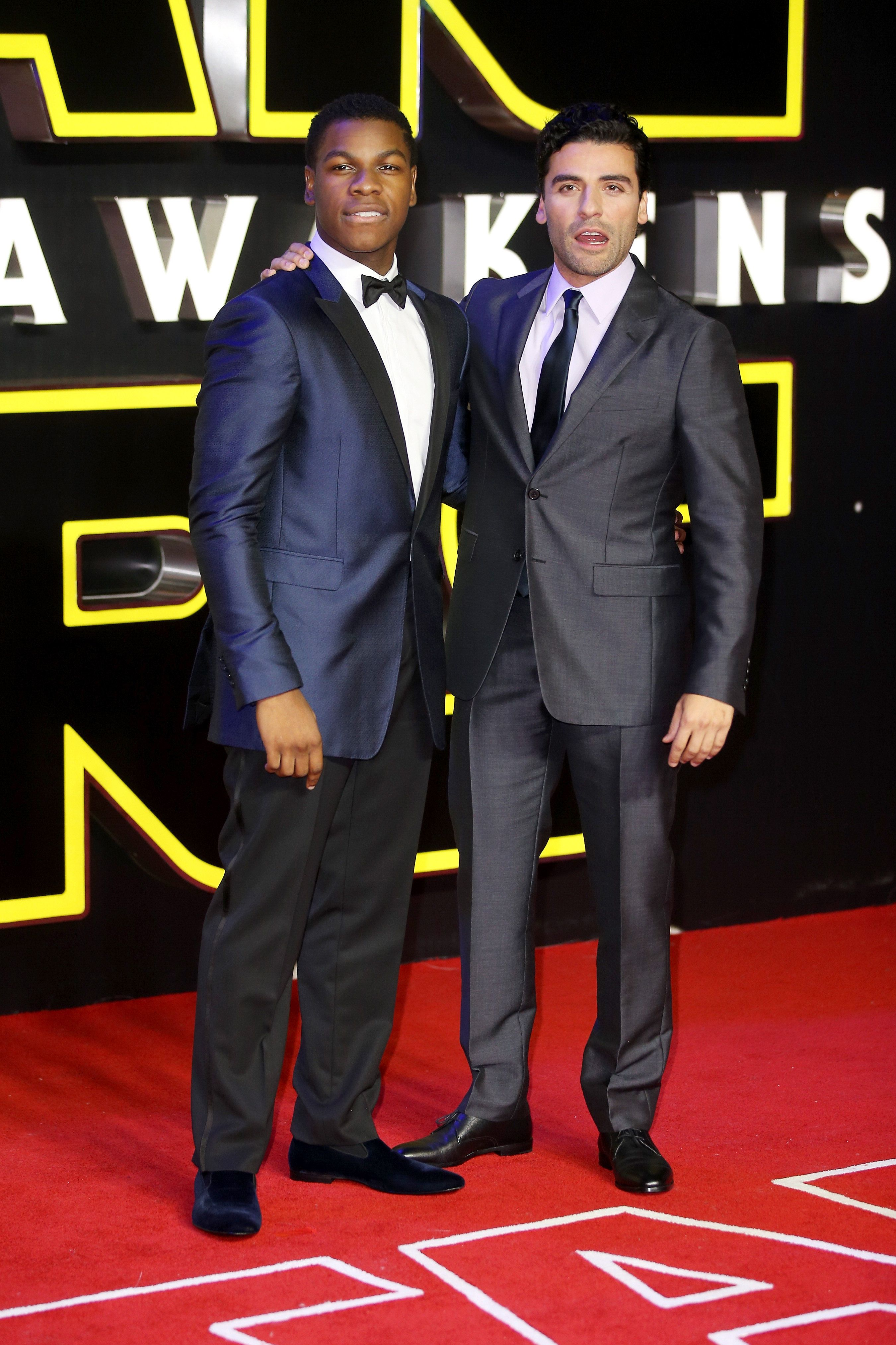 LONDON, ENGLAND - DECEMBER 16: (L-R) Actors John Boyega and Oscar Isaac attend the European Premiere of 'Star Wars: The Force Awakens' at Leicester Square on December 16, 2015 in London, England.  (Photo by Mike Marsland/WireImage)