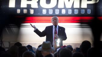 BENTONVILLE, AR - FEBRUARY 27:  Republican Presidential candidate Donald Trump bashes Republican rival Marco Rubio as he talks to supporters at a campaign rally in an airplane hanger at Northwest Arkansas Regional Airport on February 27, 2016 in Bentonville, Arkansas. Georgians will vote on Super Tuesday, March 1, for their candidates for president.  (Photo by Benjamin Krain/Getty Images)
