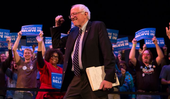 "Bernie Sanders gives the crowd a fist as he enters the ""Get Out The Vote"" rally and concert at Township Auditorium in Co"
