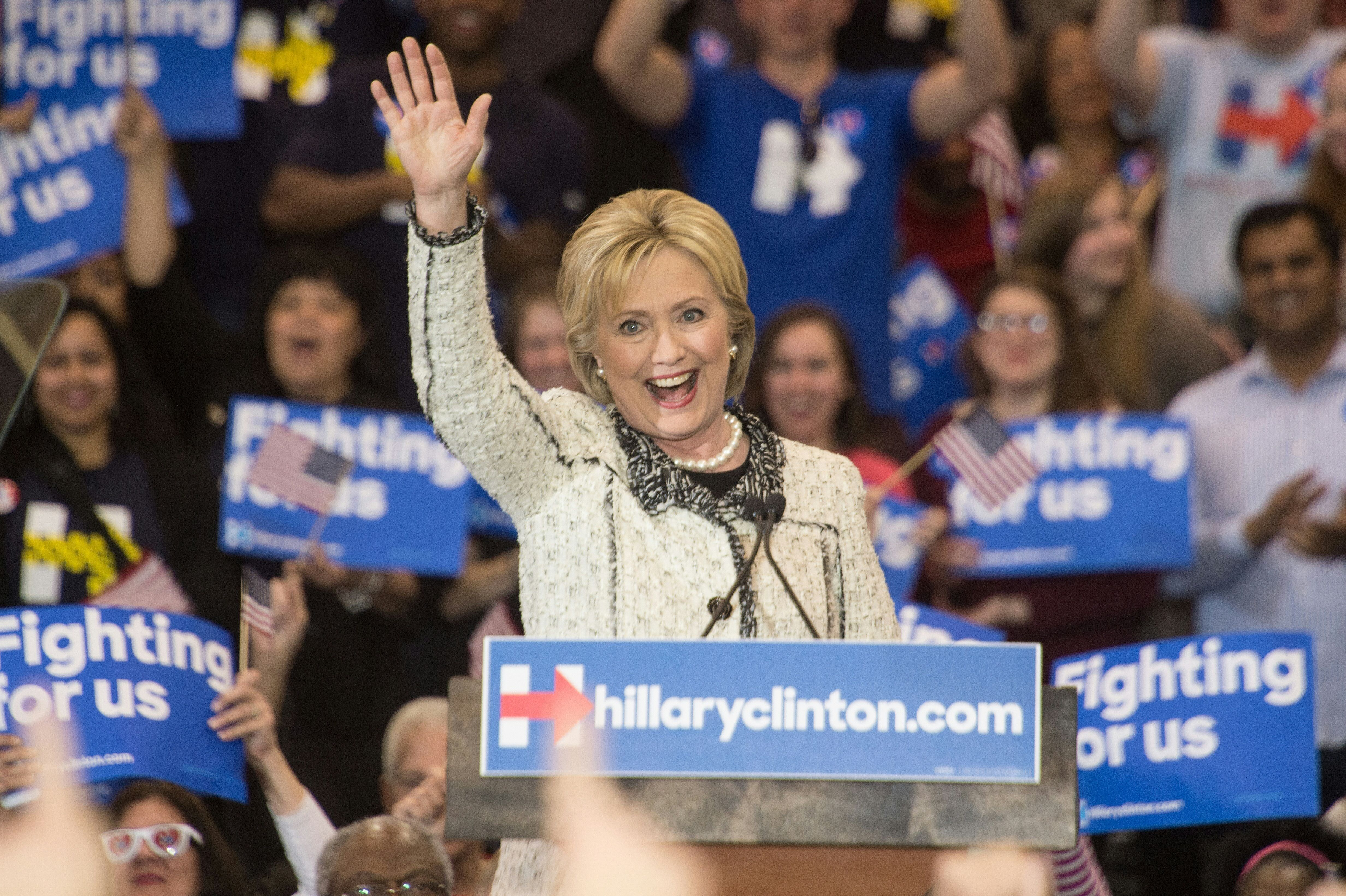 US Democratic presidential candidate Hillary Clinton waves after addressing a primary night rally in Columbia, South Carolina, on February 27, 2016. Clinton defeated Bernie Sanders by an overwhelming margin in the Democratic primary in South Carolina, projections showed, seizing momentum ahead of the most important day of the nomination race: next week's 'Super Tuesday' contests. / AFP / Nicholas Kamm        (Photo credit should read NICHOLAS KAMM/AFP/Getty Images)