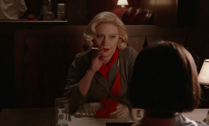 "Kate McKinnon as Carol in ""Carol,"" trying to seduce Rooney Mara's Therese."