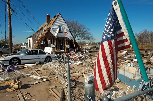 A house in Staten Island, New York, hit in Hurricane Sandy. Scientists say we should prepare for...
