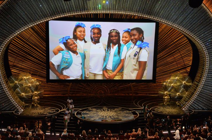 Chris Rock's daughters and Girl Scouts troop are seen on a screen on stage at the 88th Oscars on February 28, 2016 in Hollywo