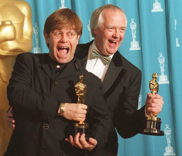 "In 1995, John (left) won an Oscar for Best Original Song for ""<a href=""https://www.youtube.com/watch?v=F-EsrOB1yNg"" target=""_"