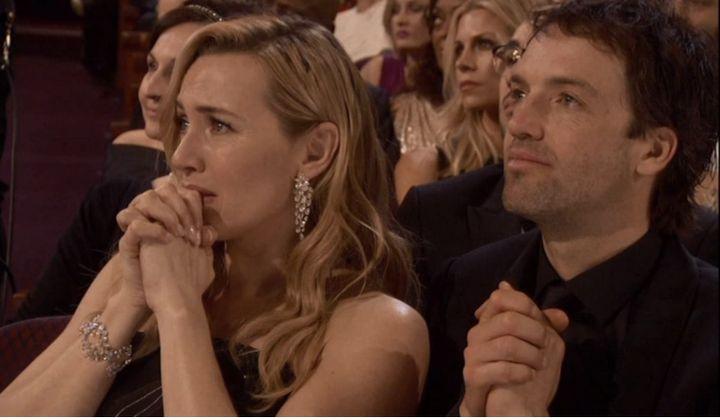 Kate Winslet reacts to Leonardo DiCaprio's Oscar win.
