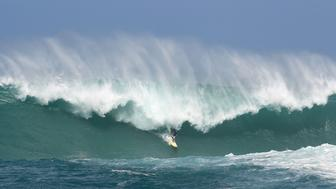 WAIMEA, HI - FEBRUARY 25:  Professional surfer Mason Ho rides a wave at The Quiksilver in Memory of Eddie Aikau at Waimea Bay on February 25, 2016 in Waimea, Hawaii.  (Photo by Darryl Oumi/Getty Images)