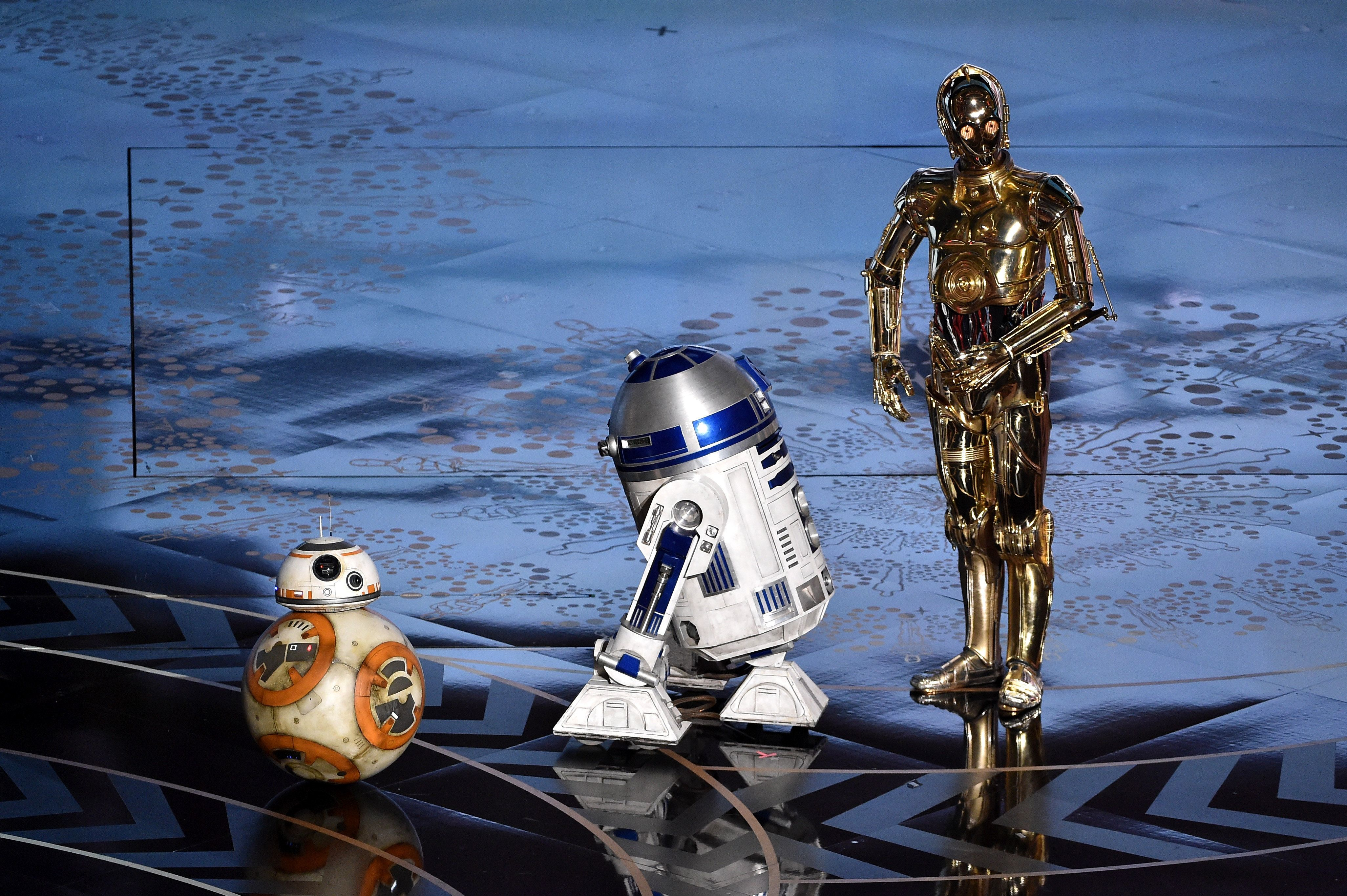 HOLLYWOOD, CA - FEBRUARY 28:  (L-R) BB-8, R2-D2 and C-3PO from 'Star Wars' appear onstage during the 88th Annual Academy Awards at the Dolby Theatre on February 28, 2016 in Hollywood, California.  (Photo by Kevin Winter/Getty Images)
