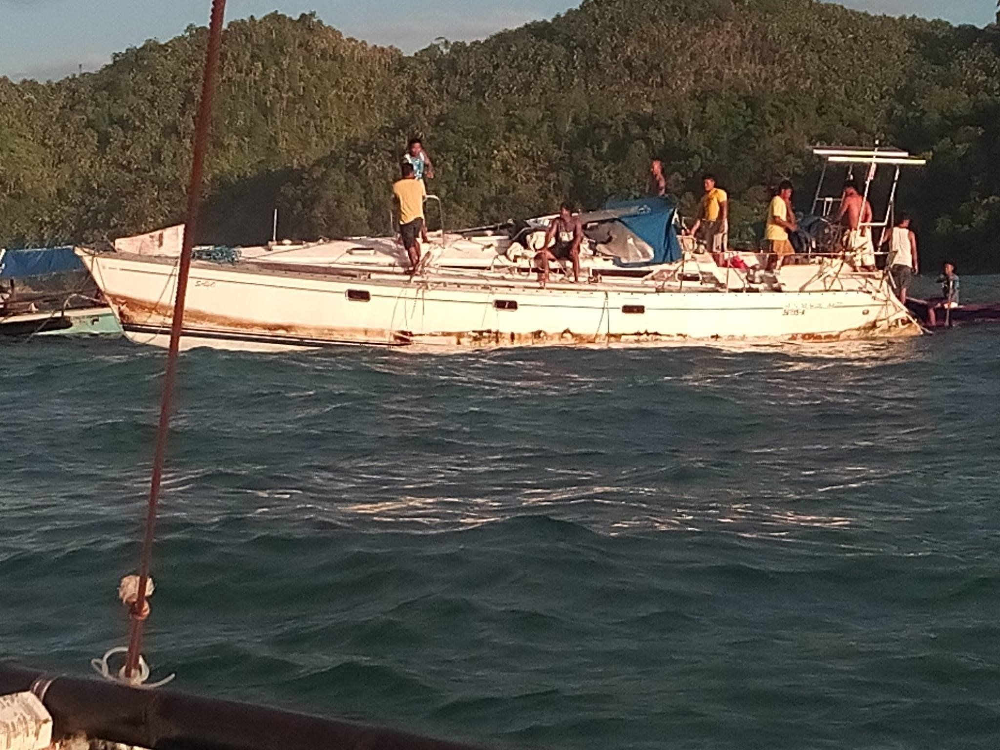 Fishermen reported finding the mummifiedbody of a maninside this drifting yacht.