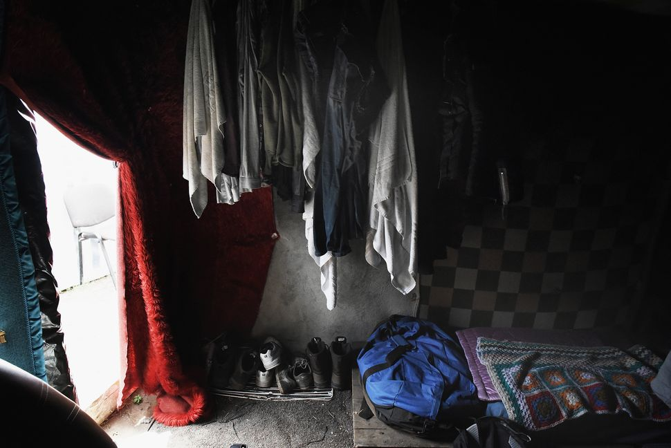 "Inside the home of Mohammed, who had lived in Calais for just seven weeks when the photo was taken. ""Sometimes eight people a"