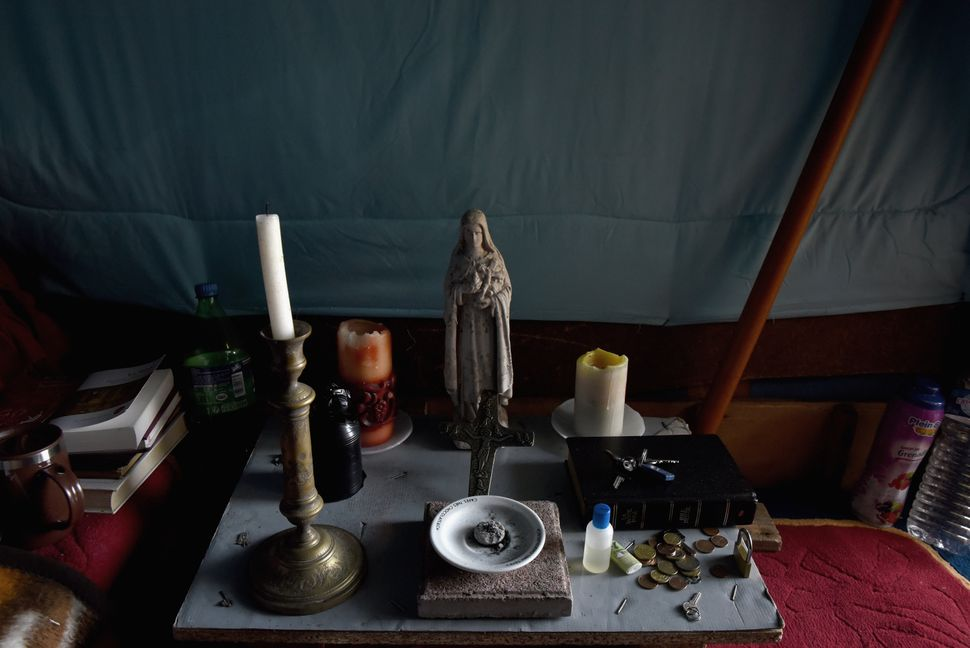 "Inside the home of Marco, who had been in Calais for five and a half months. ""I pray every day that God will get me to s"