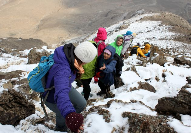 Afghan women and girls, all part of an organization called Ascend, hike to the top of a mountain in Kabul,...