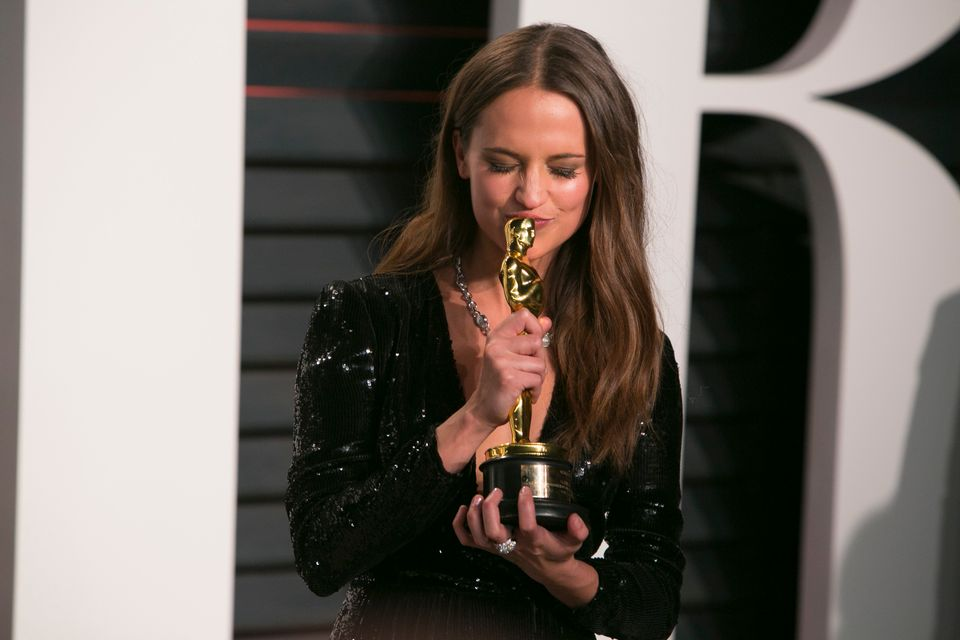 Alicia Vikander holds her Oscar for best supporting actress in her role 'The Danish Girl' as she arrives to the 2016 Vanity F