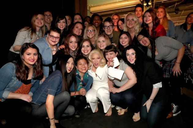 Lady Gaga poses backstage with sexual assault survivors who joined her during her performance at the...