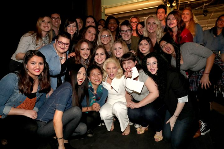 Lady Gaga poses backstage with sexual assault survivors who joined her during her performance at the 88th Academy Awards on S