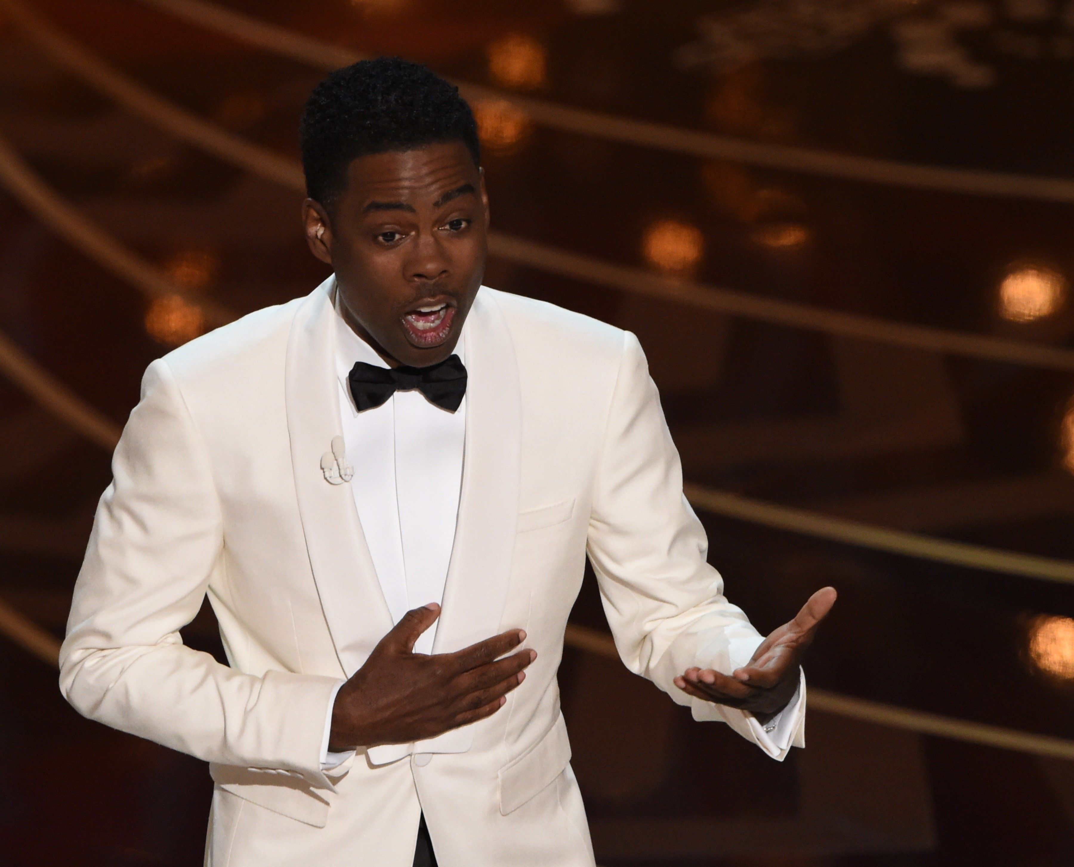 Actor Chris Rock presents on stage at the 88th Oscars on February 28, 2016 in Hollywood, California. AFP PHOTO / MARK RALSTON / AFP / MARK RALSTON        (Photo credit should read MARK RALSTON/AFP/Getty Images)