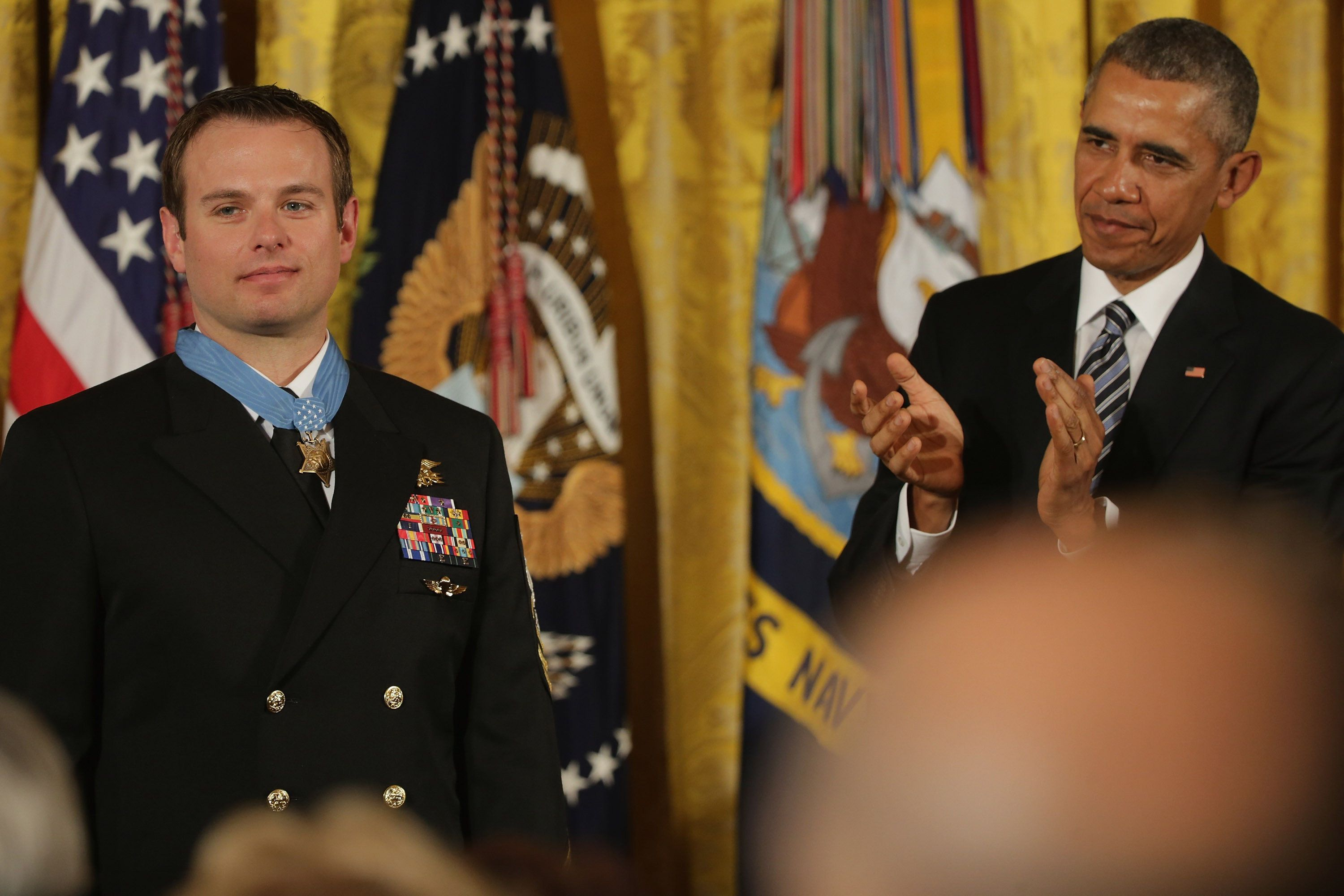 U.S. President Barack Obama applauds after presentibng Navy Senior Chief Edward Byers Jr., 36, with the Medal of Honor during a ceremony in the East Room of the White House February 29, 2016 in Washington, DC. A member of Navy SEAL Team 6, Byers received the Medal of Honor for his role in rescuing an American hostage from the Taliban in Afghanistan in December 2012.