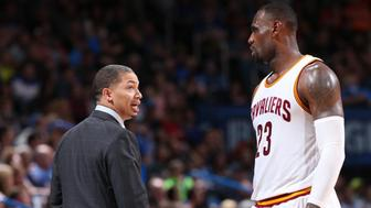 OKLAHOMA CITY, OK- FEBRUARY 21:  Head coach Tyronn Lue of the Cleveland Cavaliers talks with LeBron James #23 of the Cleveland Cavaliers during the game against the Oklahoma City Thunder on February 21, 2016 at Chesapeake Energy Arena in Oklahoma City, Oklahoma. NOTE TO USER: User expressly acknowledges and agrees that, by downloading and or using this photograph, User is consenting to the terms and conditions of the Getty Images License Agreement. Mandatory Copyright Notice: Copyright 2016 NBAE (Photo by Joe Murphy/NBAE via Getty Images)