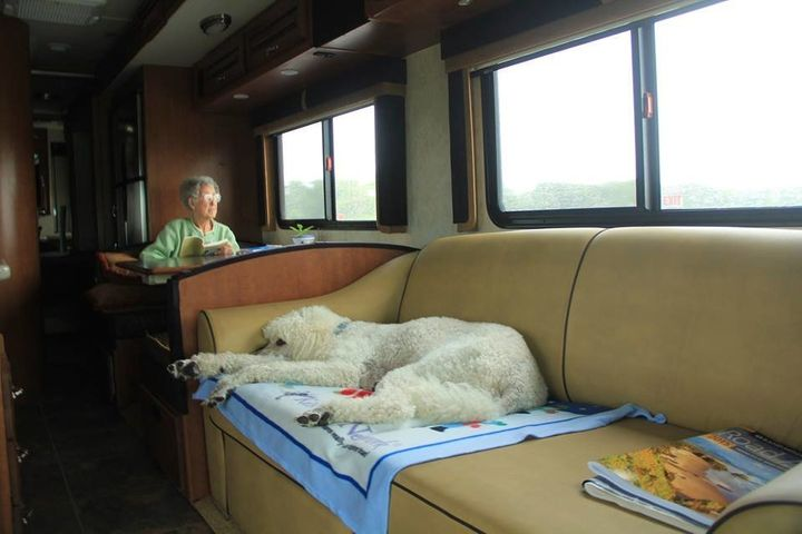 Norma relaxing inside the RV.