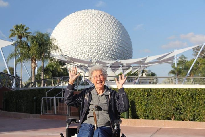 Norma posing in front of Epcot at Disney World.