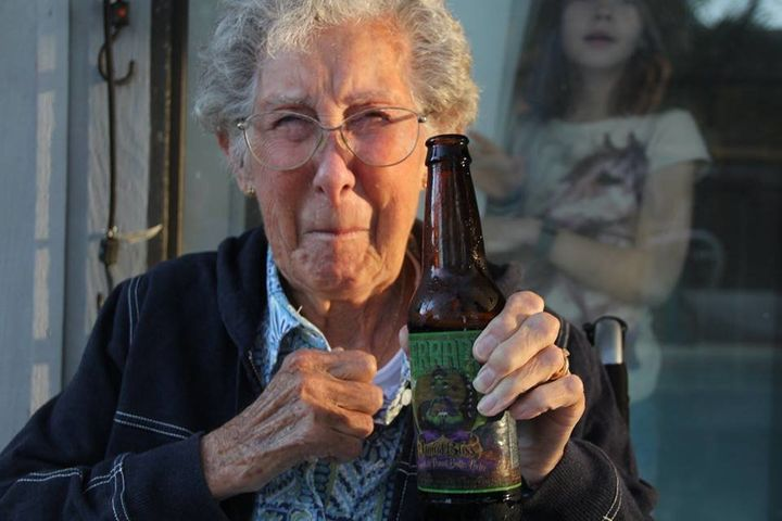 Norma enjoying a cold brew.