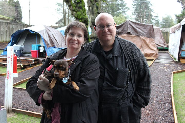 <br>Kim and Brad Lancaster and their dog, Sofie.