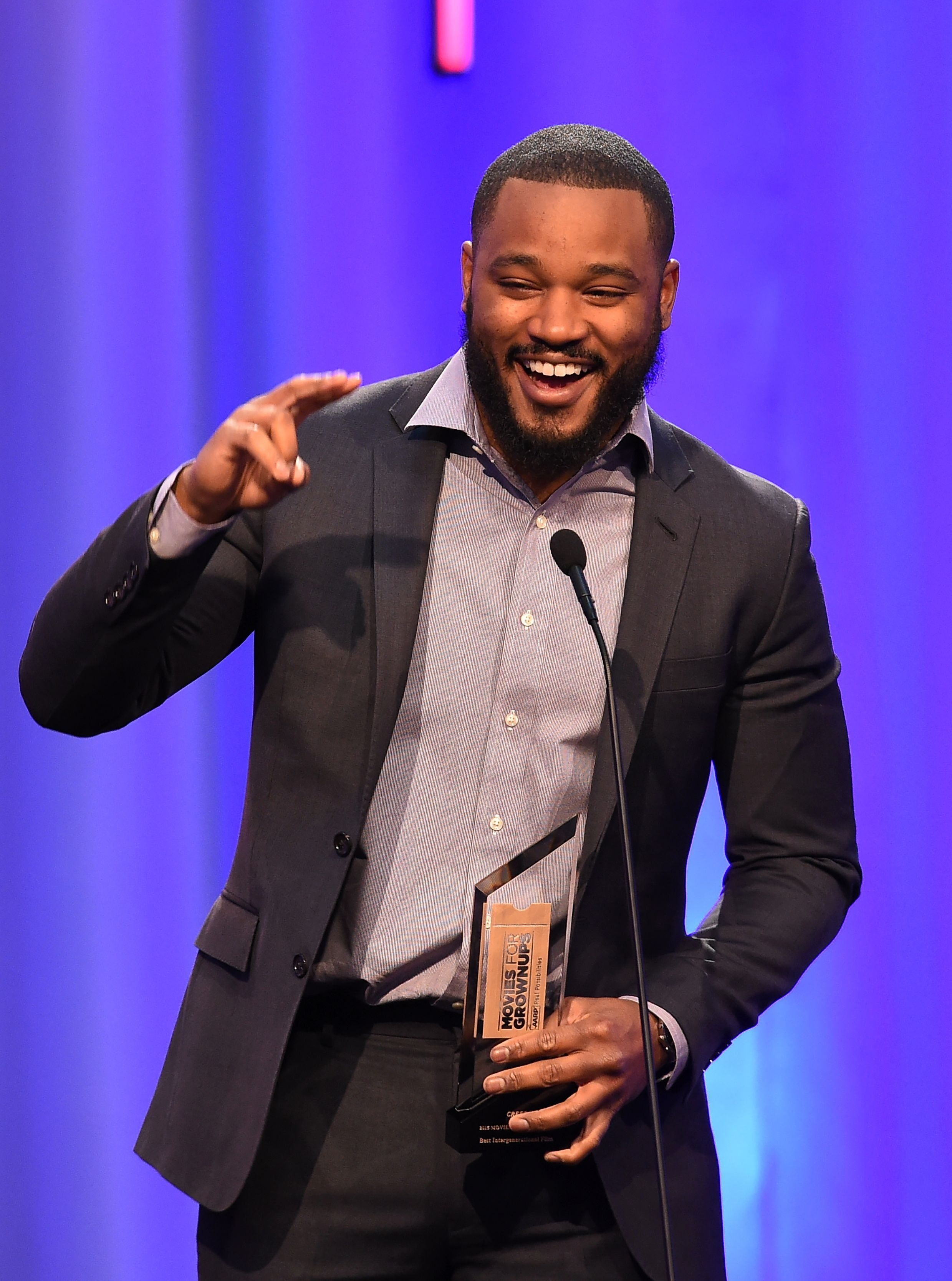 Director Ryan Coogler accepts the Best Integenerational Movie award for 'Creed'  at the AARP 15th Annual Movies For Grownups Awards, February 8, 2016, at the Beverly Wilshire Hotel in Beverly Hills, California. / AFP / ROBYN BECK        (Photo credit should read ROBYN BECK/AFP/Getty Images)