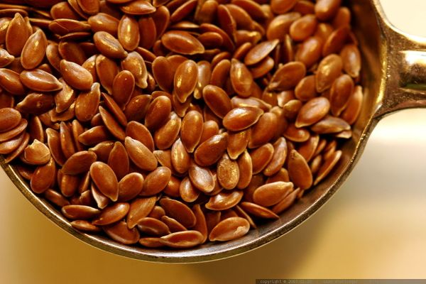 "One <a href=""http://ndb.nal.usda.gov/ndb/foods/show/3745"" target=""_blank"">tablespoon of whole flaxseed</a> -- which you can <"