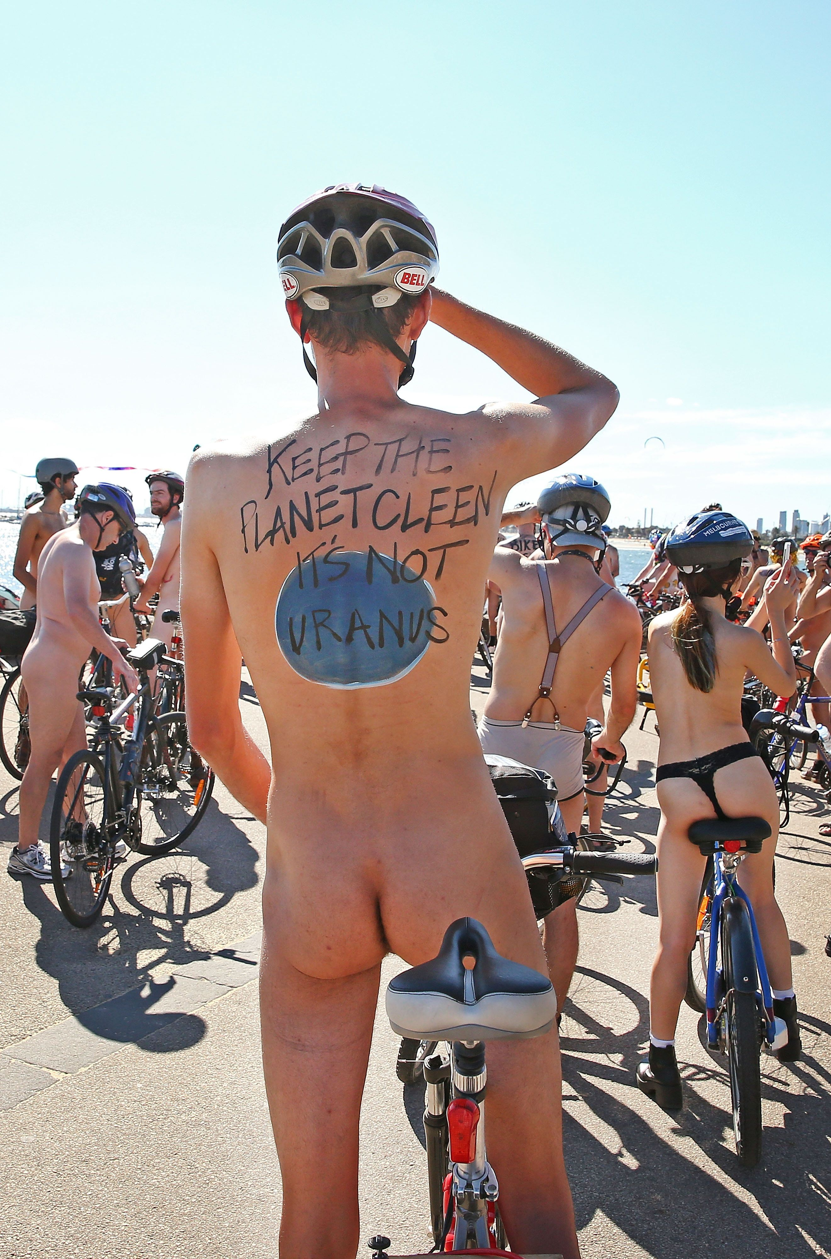 MELBOURNE, AUSTRALIA - FEBRUARY 28:  (EDITORS NOTE: Image contains nudity.) Naked bike riders cycle past St Kilda Beach during the 2016 World Naked Bike Ride on February 28, 2016 in Melbourne, Australia.  The World Naked Bike Ride is an annual international clothing-optional bike ride in which participants ride together to peacefully protest issues including body image, cyclists safety and alternative lifestyles.  (Photo by Scott Barbour/Getty Images)
