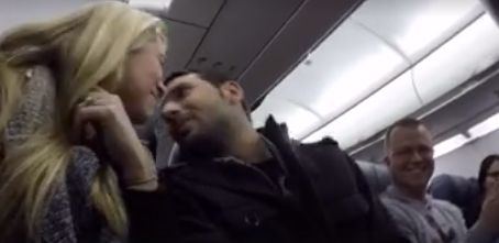 The couple shared a kiss after the news was announced over the airplane's