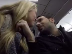 The couple shared a kiss after the news was announced over the airplane's intercom.