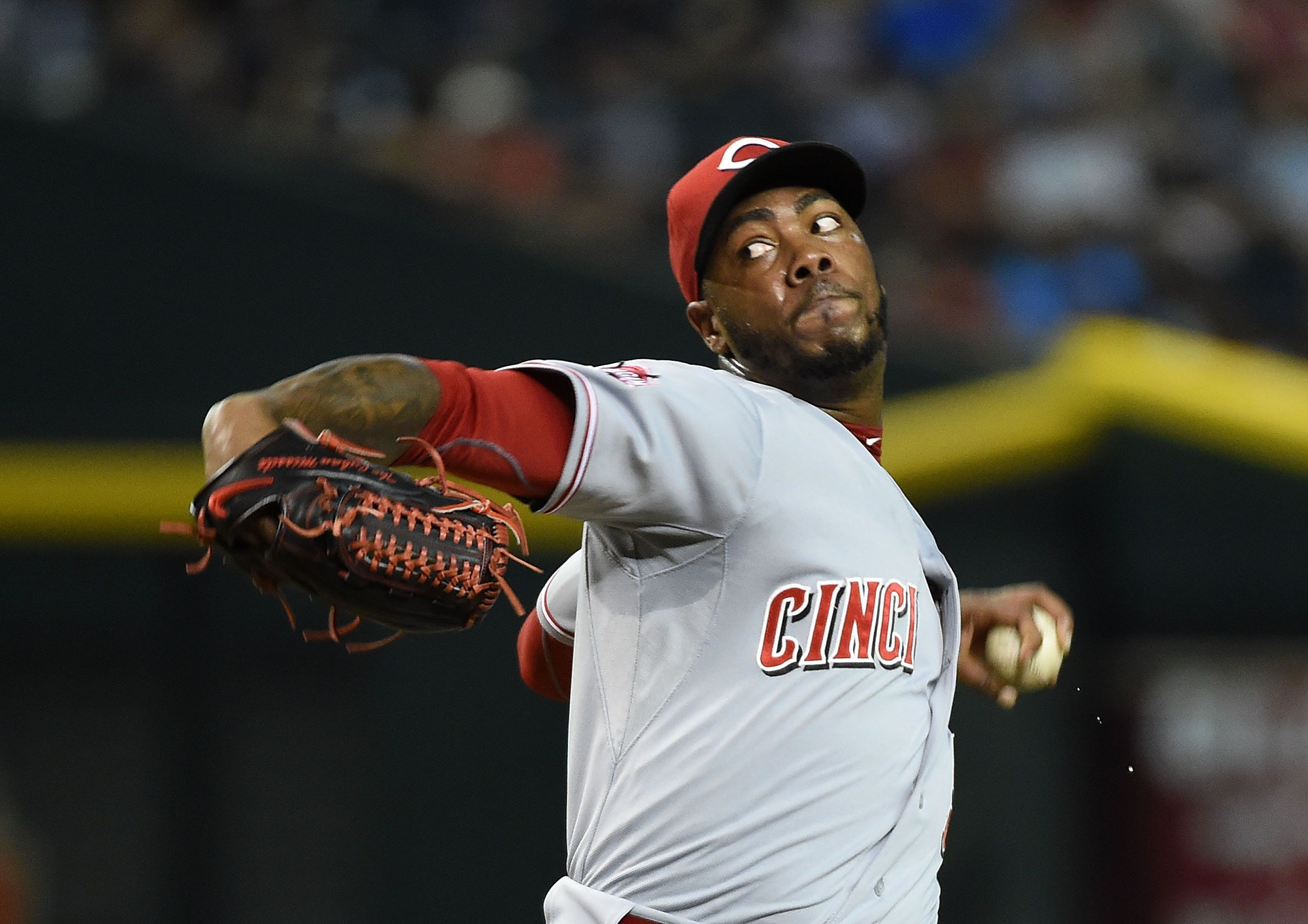 PHOENIX, AZ - AUGUST 08:  Aroldis Chapman #54 of the Cincinnati Reds delivers a pitch against the Arizona Diamondbacks at Chase Field on August 8, 2015 in Phoenix, Arizona.  (Photo by Norm Hall/Getty Images)