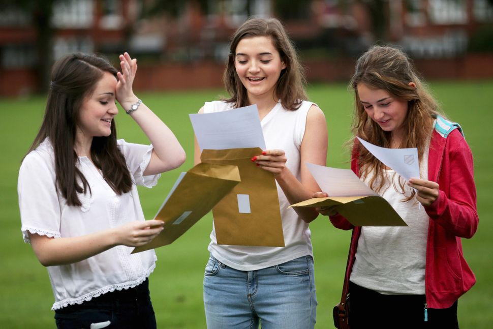 Withington Independent Girls School students celebrate getting good grades on their A level exams on August 15, 2013 in Manch