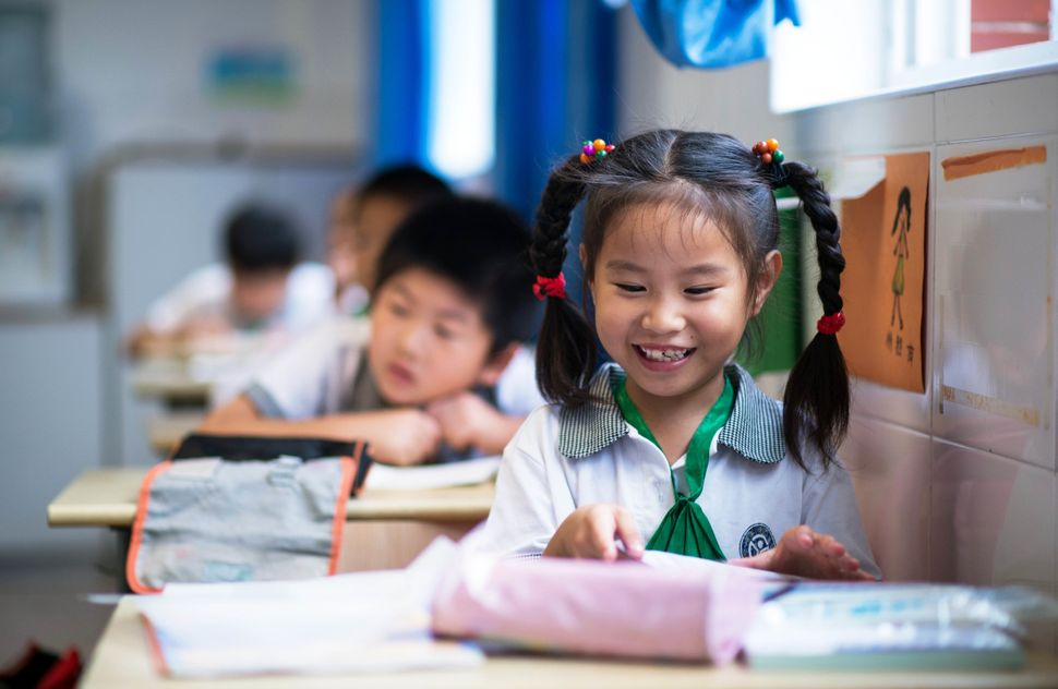 Chinese children attend a class at the Jinqao Center Primary School in Shanghai on September 1, 2014.
