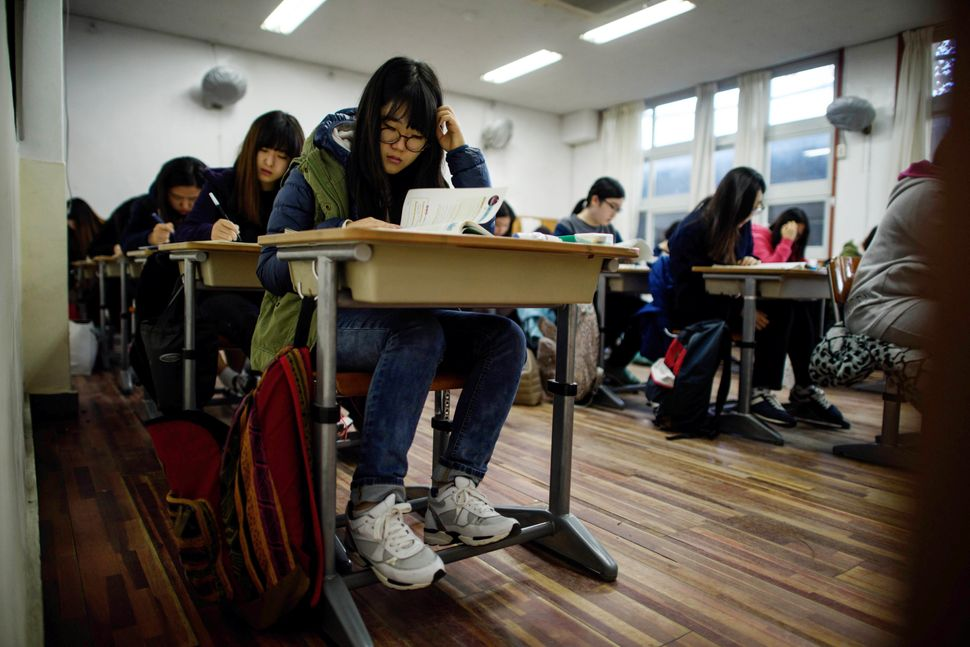 Students take the annual Scholastic Aptitude Test at the Poongmun high school in Seoul on November 13, 2014.