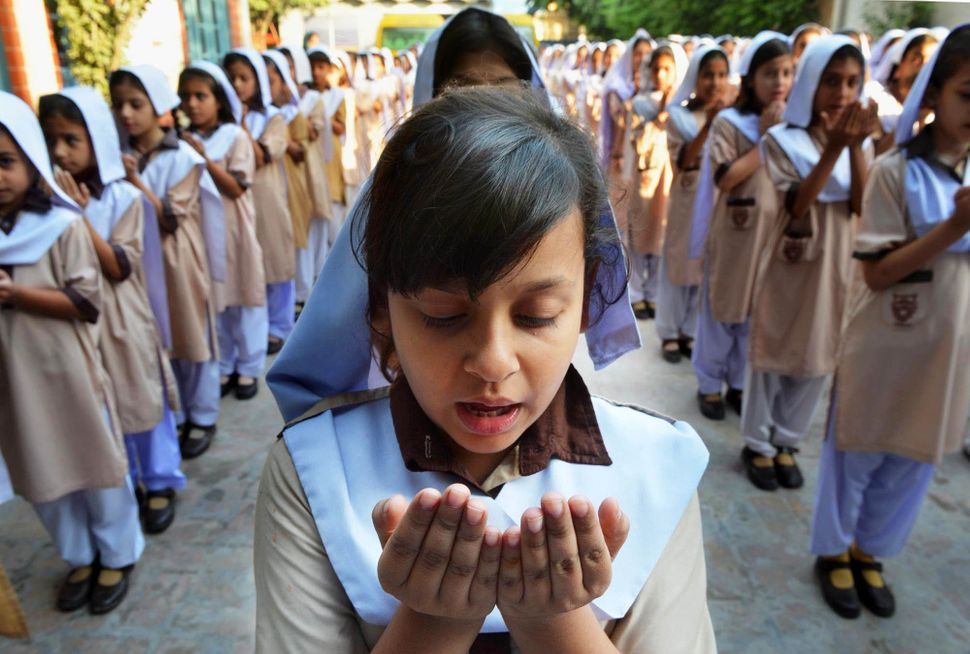 "Pakistani school girls pray for the early recovery of child activist <a href=""http://www.biography.com/people/malala-yousafza"