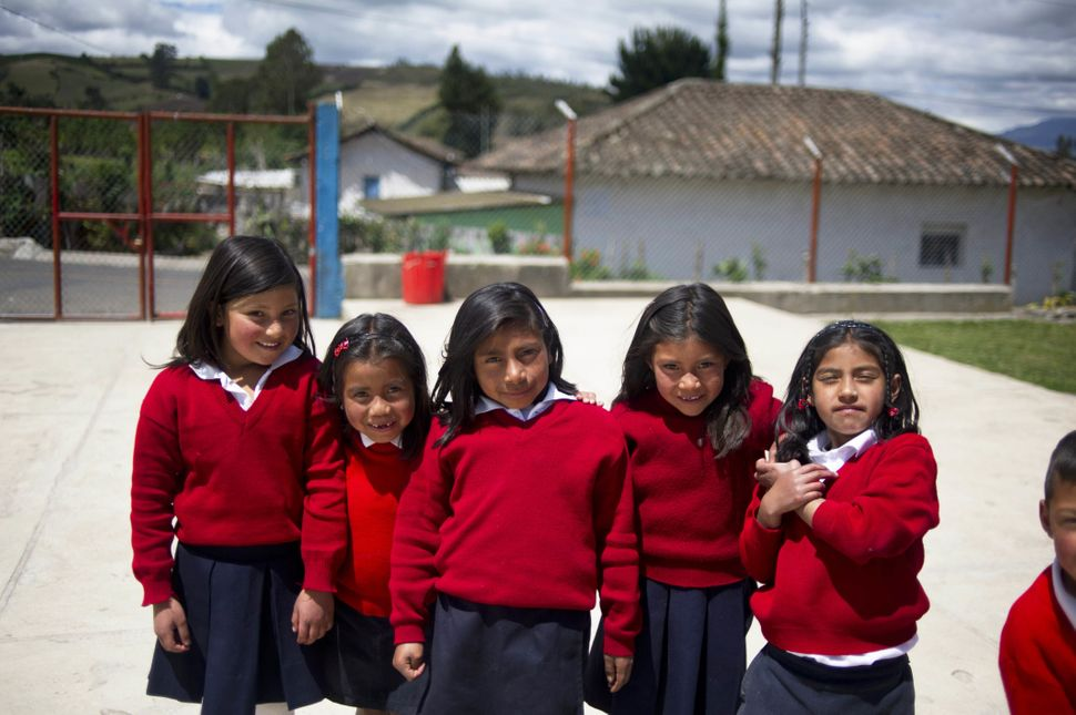 Girls pose at a rural school at La Palizada in Tulcan, Carchi province, in Ecuador close to the Colombian border on November