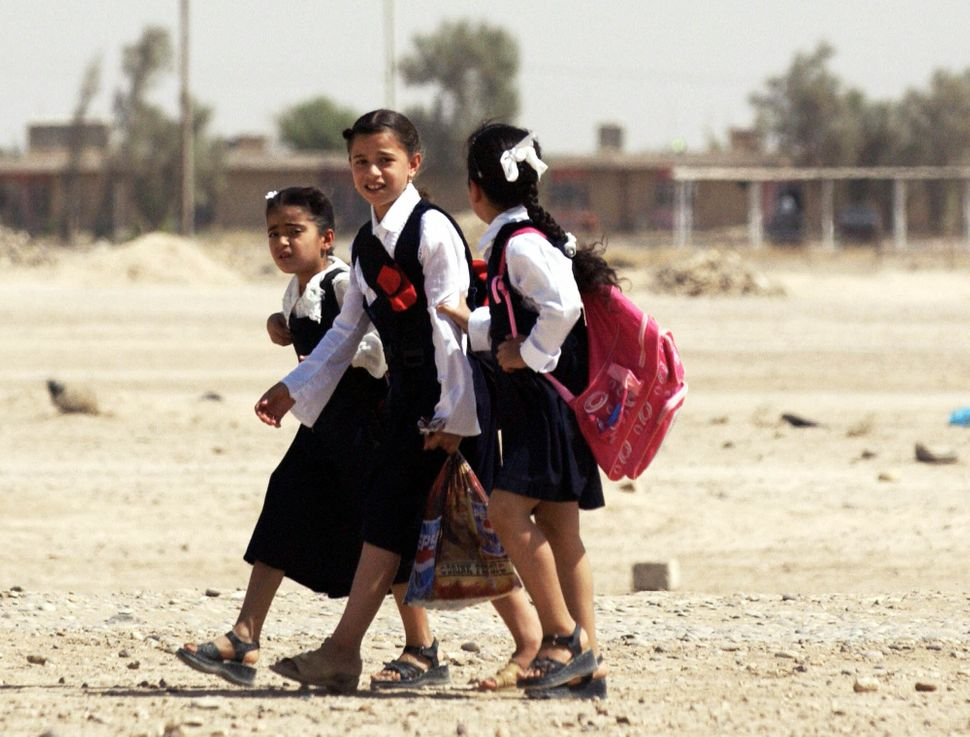 Iraqi school girls walk home in Tikrit on September 22, 2005.
