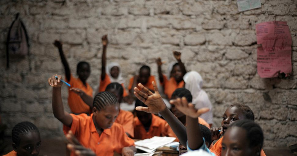 "Schoolgirls participate in a lesson in Kilifi, Kenya on June 31, 2010. The students are part of an initiative called ""Mo"