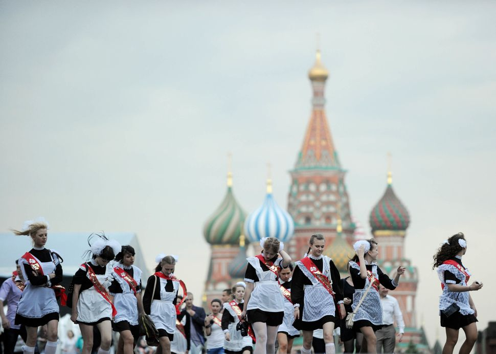 High-school graduates celebrate the last day of their classes in Moscow's Red Square on May 25, 2011.