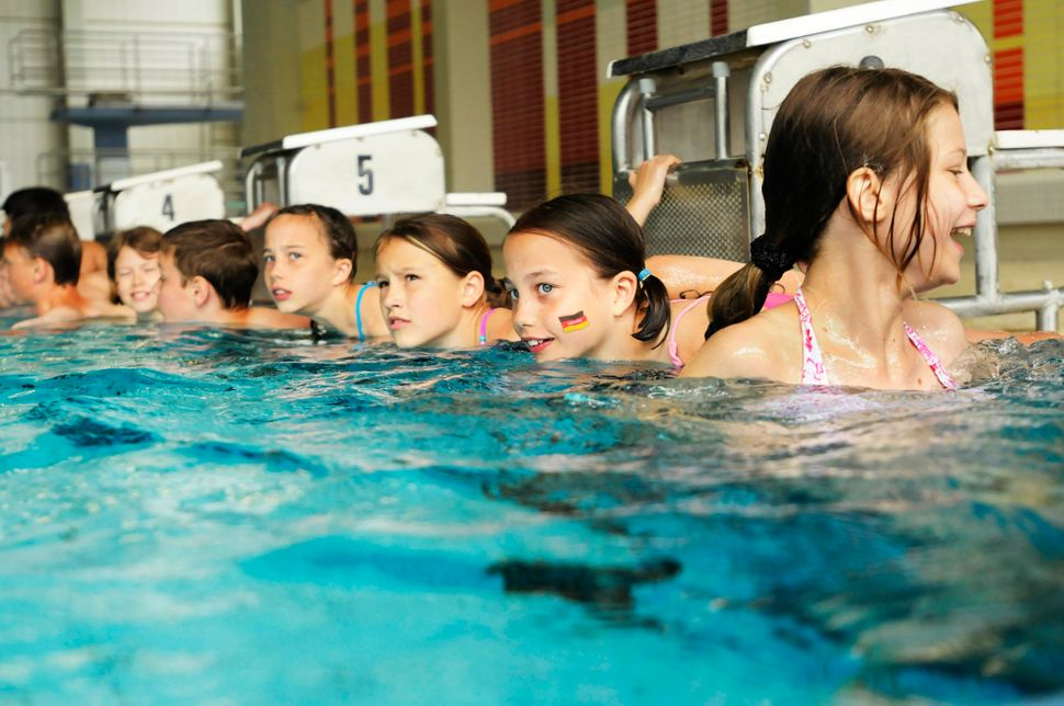 Students of the 7th and 8th classes swimming during a school triathlon on June 19, 2010 in Berlin, Germany.