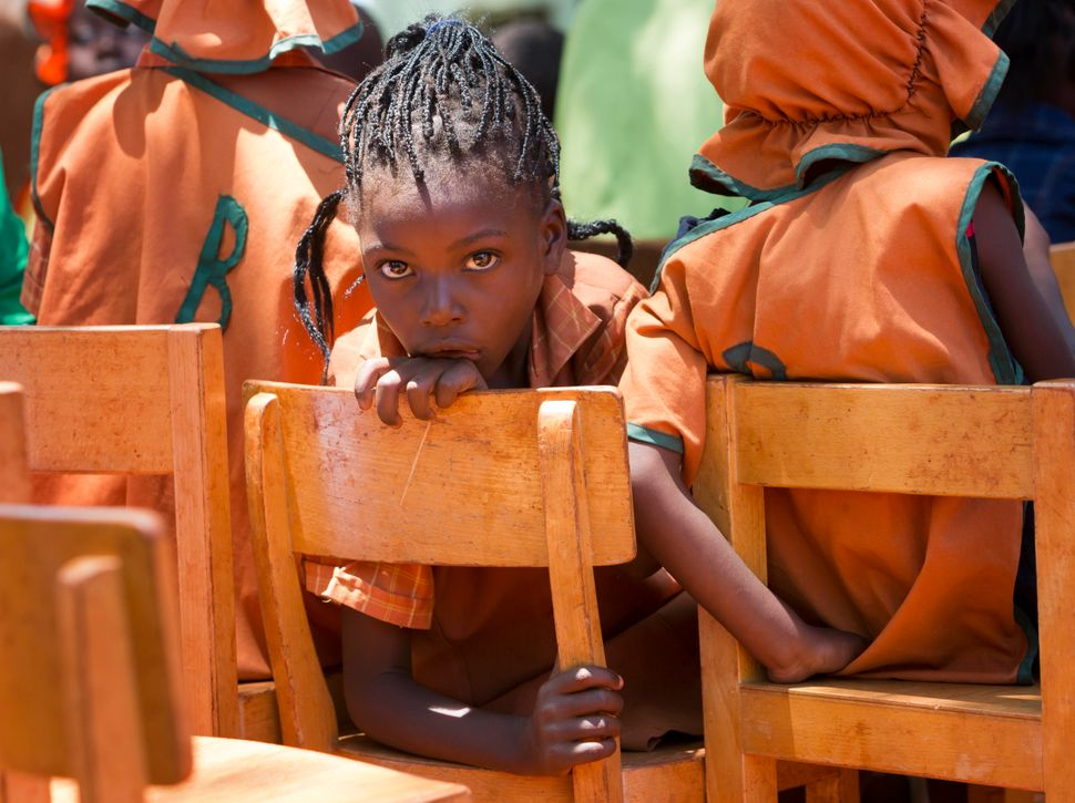 A young schoolgirl listens to a concert at the Glen Forest Development Centre on December 3, 2012 in Harare, Zimbabwe.