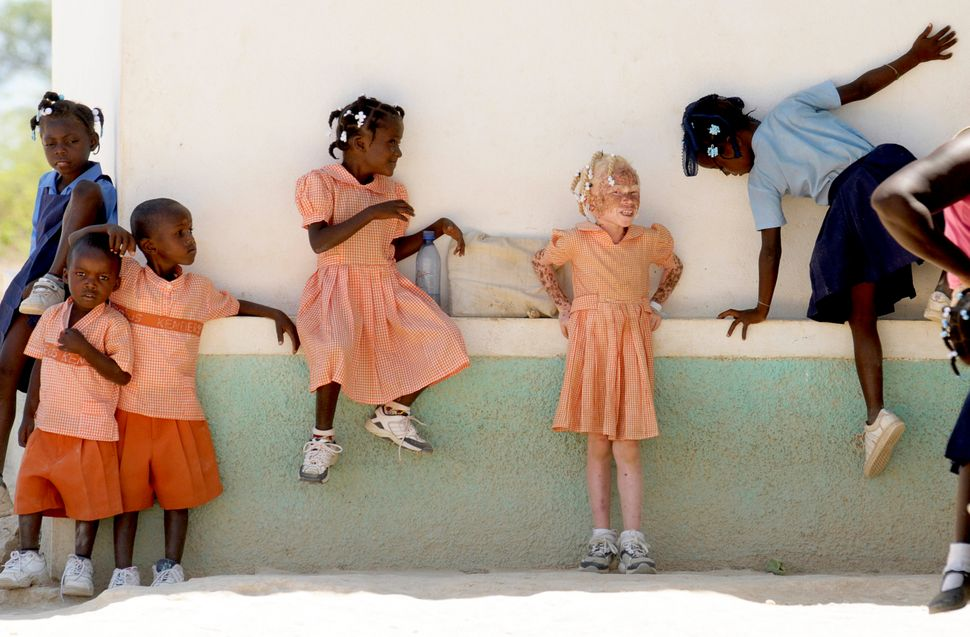 School children in uniform play in Isla de Laganave, Haiti.