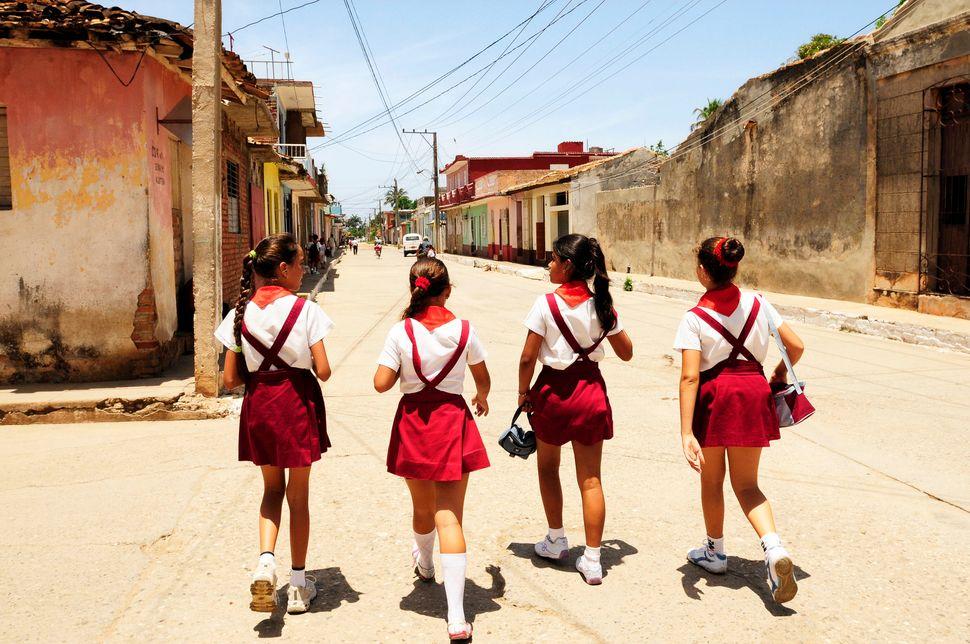 School girls wearing school uniforms on the way home on June 1, 2009 in Trinidad, Cuba.