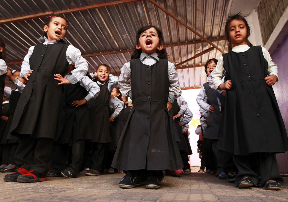 Yemeni schoolgirls attend an anti-mine and unexploded ordnance awareness campaign in a school in Sanaa on December 17, 2014.