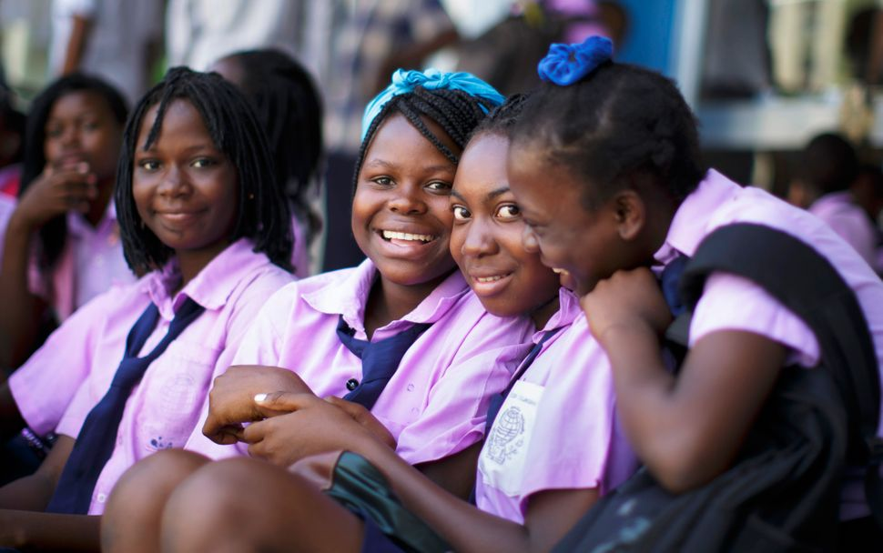 Students in school uniforms pose for a photo on September 29, 2015 in Beira, Mozambique.