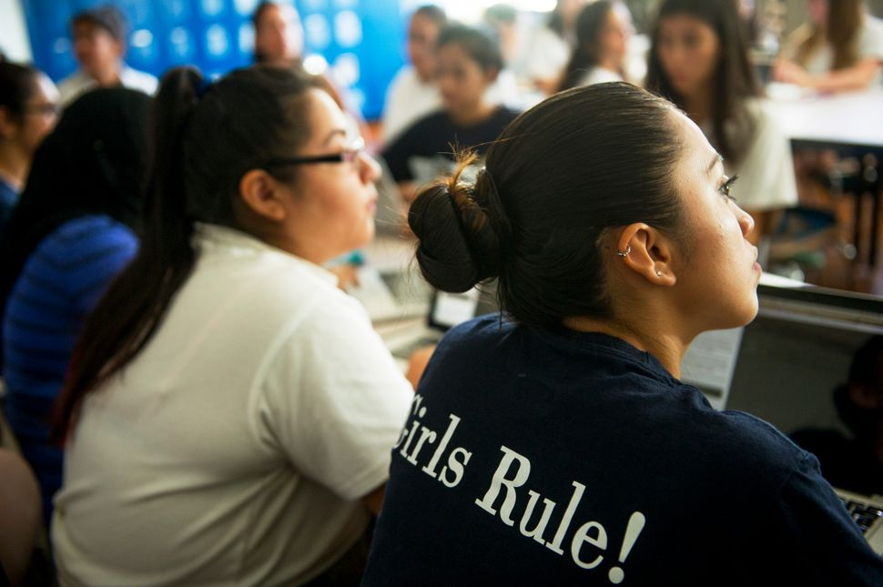 Students listen to instructions during a coding class at The Young Women's Leadership School of Astoria in New York on Septem