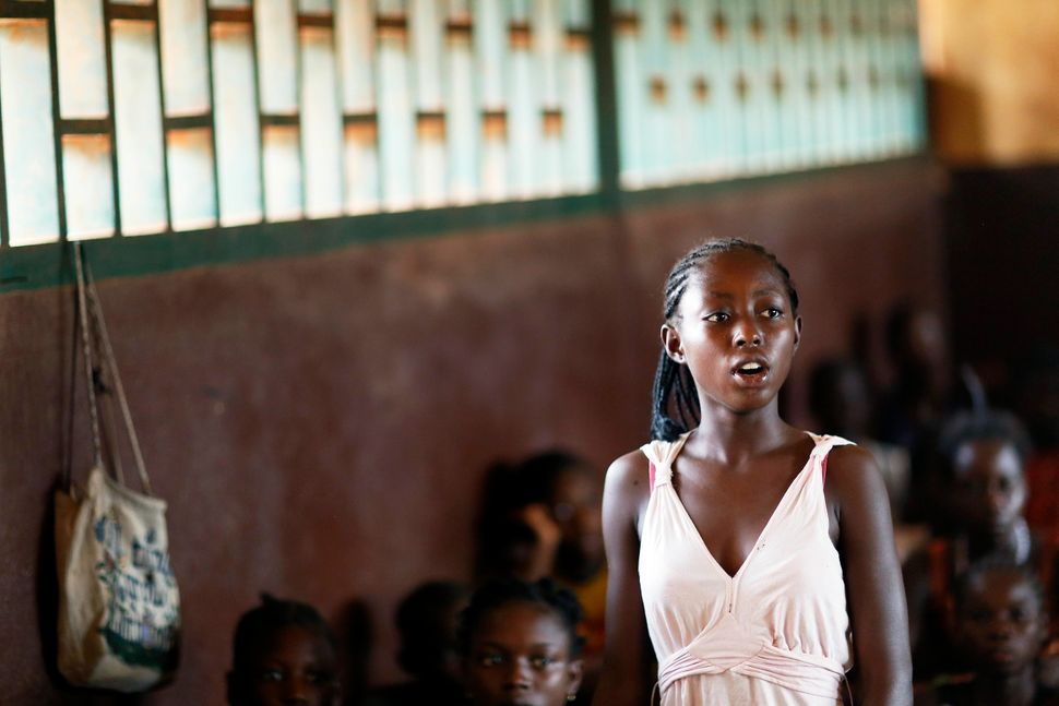 A student stands in a classroom at a school in the capital city of Bangui, Central African Republic on March 12, 2014.