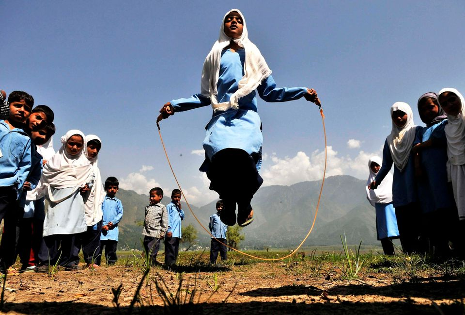 Kashmiri school girls playing during recess in Kulhama district, Bandipora on August 11, 2015 in Srinagar, India.
